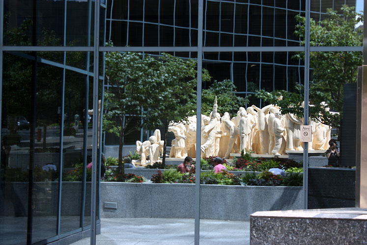 World Travel Photos :: Canada - Quebec - Montreal :: Montreal.  The Illuminated Crowd - a reflection of the statue