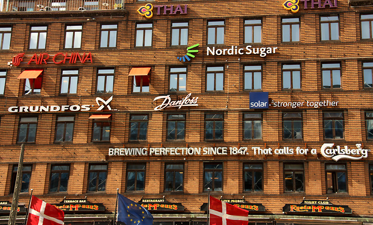 World Travel Photos :: Shop-Signs :: Copenhagen. A fragment of building covered with advertisement in the city center