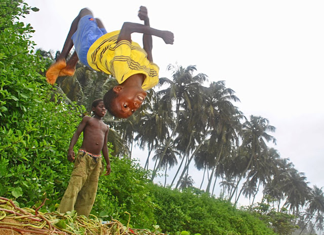 World Travel Photos :: Feel good photos :: Liberia, Africa on the beach. Great back flip!
