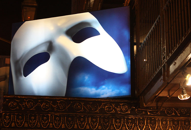 World Travel Photos :: USA - New York City :: New York City. Phantom mask at the top of the theatre on Broadway