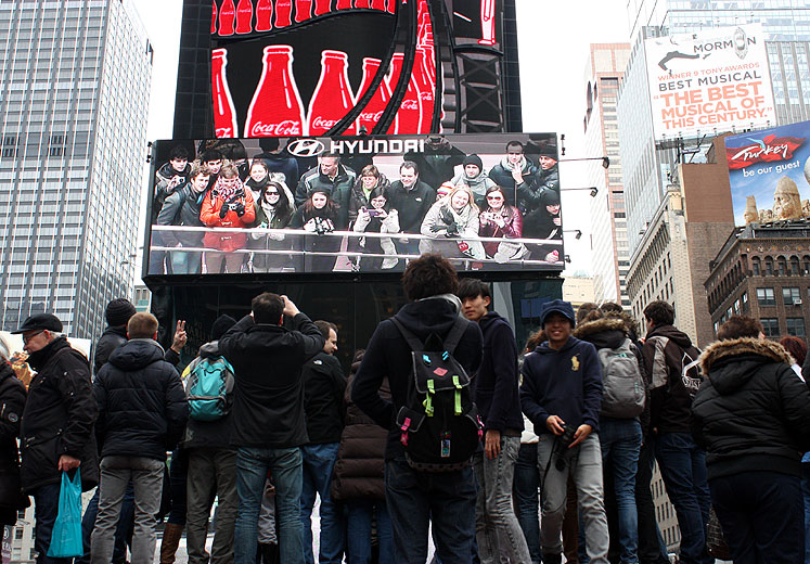 World Travel Photos :: Times Square :: New York City. Tourists looking at themselves at the big screen at Times Square